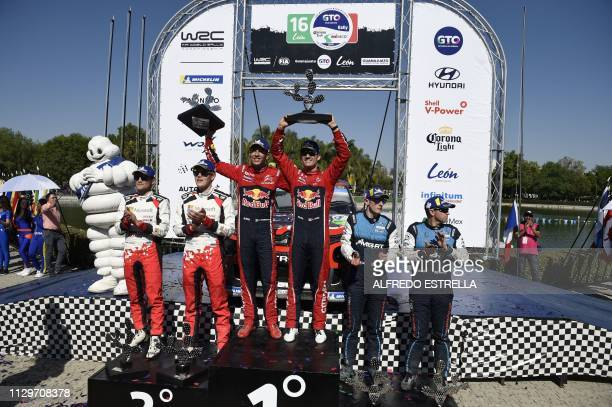 French driver Sebastien Ogier and his codriver Julien Ingrassia of the Citroen Total WRC flanked by Estonian driver Ott Tanak and his codriver Martin...
