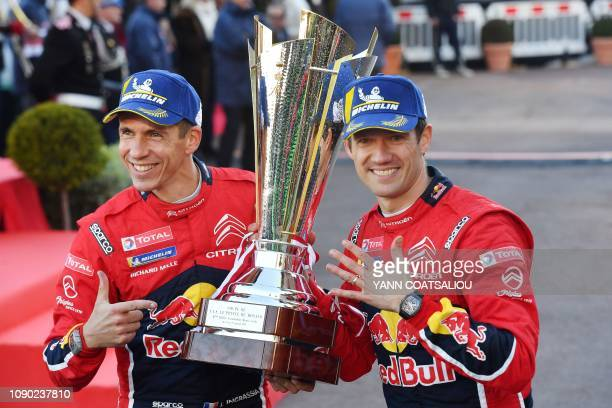 TOPSHOT French driver Sebastien Ogier and his codriver Julien Ingrassia celebrate with the trophy after winning the 87th MonteCarlo Rally on January...