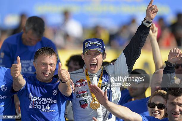 French driver Sebastien Ogier celebrates with his team after winning the 50th Rally of Catalonia and retaining his world title in Salou near...