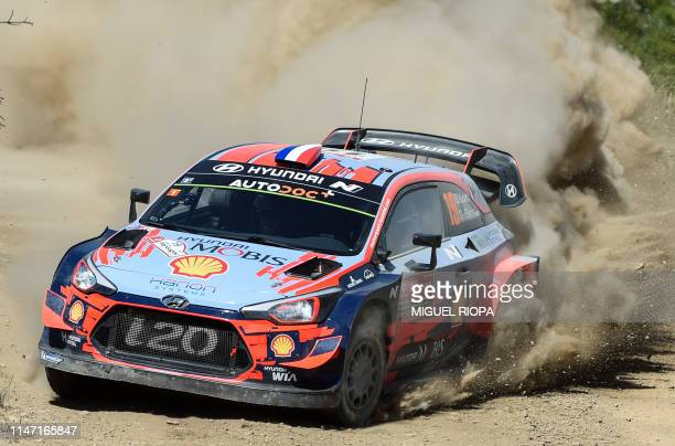 French driver Sebastien Ogier steers his Citroen C3 WRC with French codriver Julien Ingrassia during the SS2 stage of the Rally of Portugal near Gois...