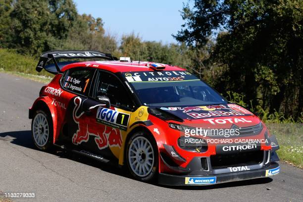 French driver Sebastien Ogier steers his Citroen Total WRT during the shakedown of the Tour de Corse part of the WRC world rally championship on the...