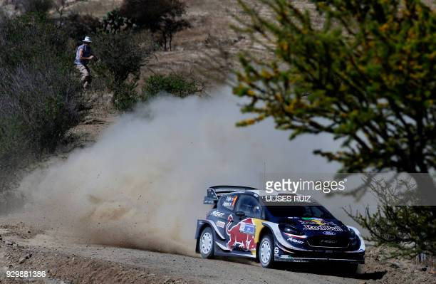 TOPSHOT French driver Sebastien Ogier steers his Ford Fiesta WRC with compatriot codriver Julien Ingrassia during the first day of the 2018 FIA World...