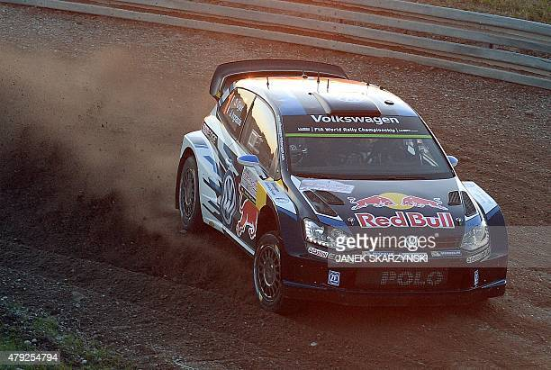 French driver Sebastien Ogier with his codriver Julien Ingrassia steer their Volkswagen Polo R WRC at Super Special Stage at Mikolajki Arena during...