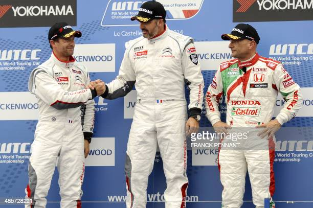 French driver second-placed Sebastien Loeb congratulates French driver first-place Yvan Muller , next to Italian driver third-placed Gabriele...