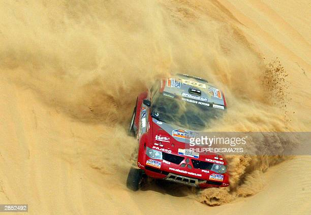 French driver Stephane Peterhansel drives his Mitsubishi 08th January 2004 during the 8th stage between Atar and Tidjika in Mauritania for the 26th...