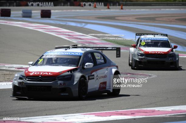 French driver Yvan Muller and French driver Sebastien Loeb takes part in a qualification session as part of the FIA World Touring Car Championship on...