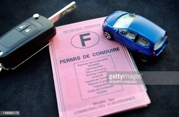 A French driving licence is displayed next to a miniature car and a car key on July 30 2012 in the French northern city of Lille AFP PHOTO / PHILIPPE...