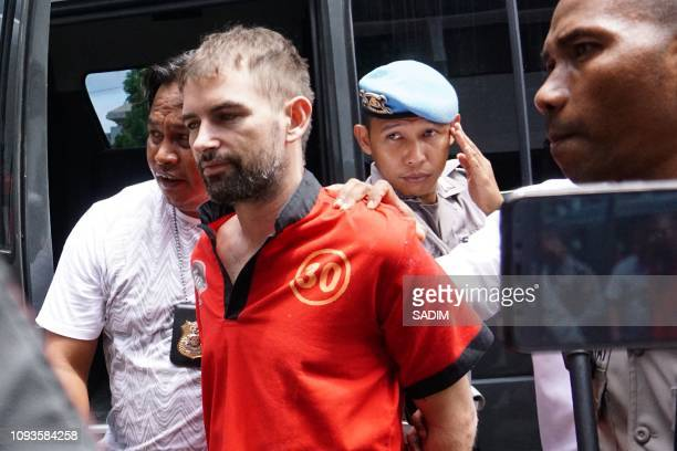 French drug suspect Felix Dorfin is guarded by Indonesian policemen at a local prosecutor'S office in Mataram West Nusa Tenggara on February 4...
