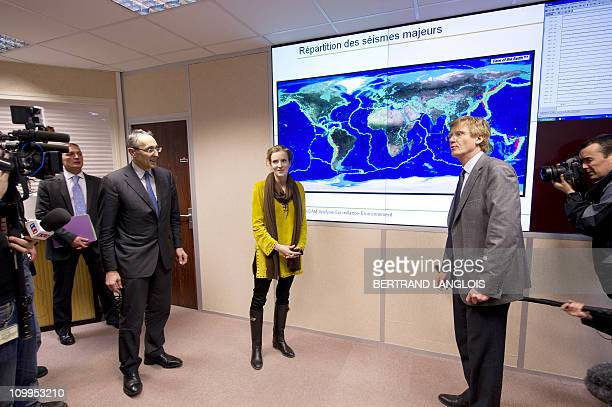 French Ecology Minister Nathalie KosciuskoMorizet is explained on March 11 the different stages of the today tsunami by French Bernard Bigot head of...