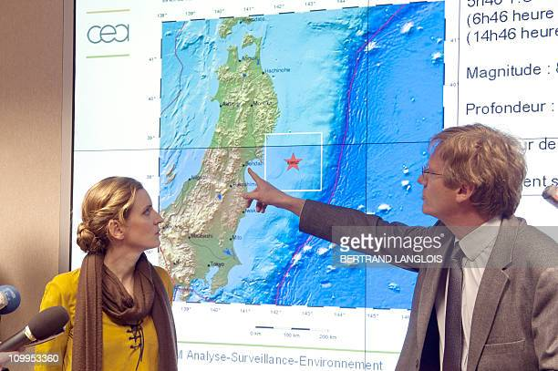 French Ecology Minister Nathalie KosciuskoMorizet is explained on March 11 the different stages of the today tsunami by French Bruno Feignier head of...