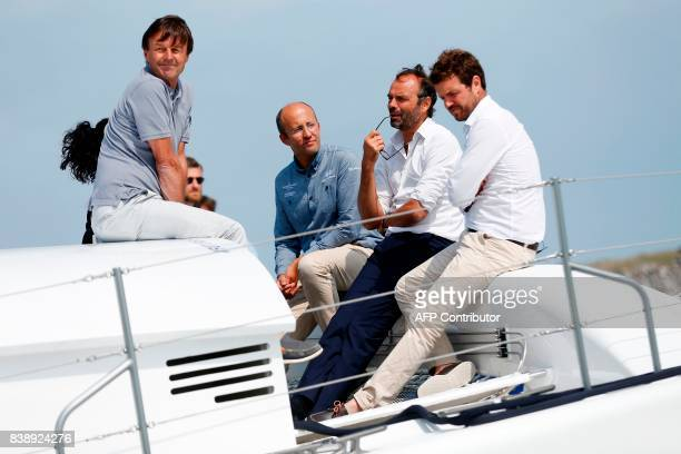 French Ecology Minister Nicolas Hulot Alternative Energies and Atomic Energy Commission engineer Didier Bouix Prime Minister Edouard Philippe and...