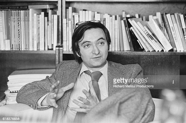French economist and essayist Jacques Attali gestures as he talks at home