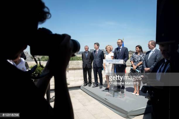 French Economist Christian Noyer Secretary of State Benjamin Grivaux President of Ile de France Region Valerie Pecresse French Prime Minister Edouard...