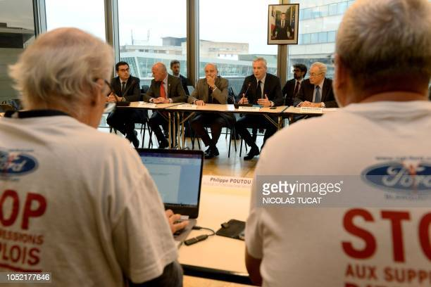 French Economy and Finance Minister Bruno Le Maire and Bordeaux's mayor Alain Juppe attend a meeting with Ford Blanquefort unionists among whom...