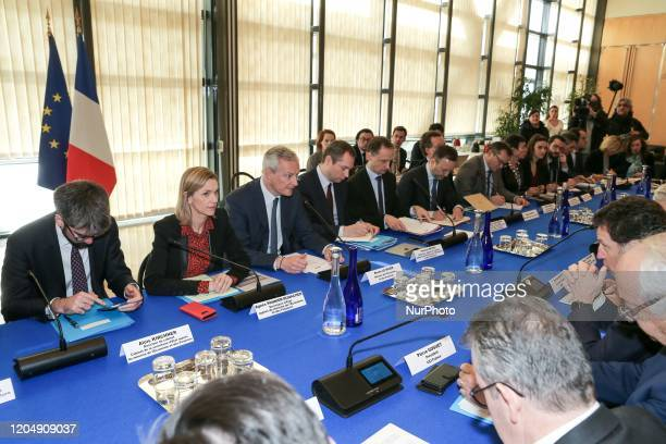 French Economy and Finance Minister Bruno Le Maire and French Junior Minister for Economy and Finance Agnes PannierRunacher attend a meeting about...