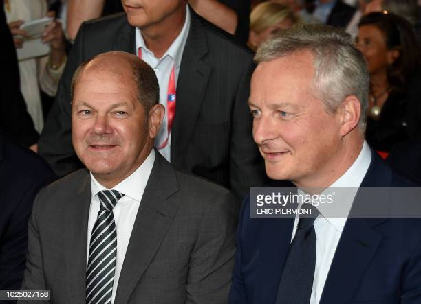 French Economy and Finance Minister Bruno Le Maire and German Finance Minister and ViceChancellor Olaf Scholz attend a plenary session on the second...