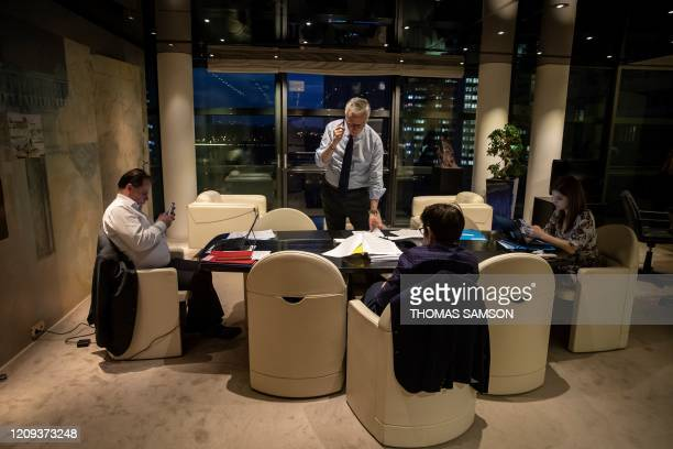 TOPSHOT French Economy and Finance Minister Bruno Le Maire gives a phone call in his office with his cabinet director Emmanuel Moulin his advisor...