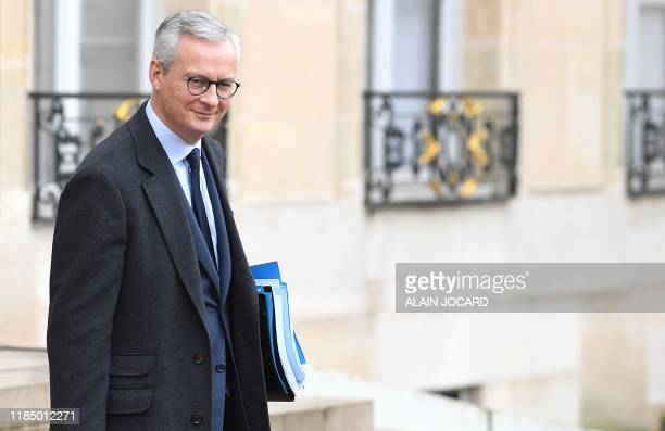 French Economy and Finance Minister Bruno Le Maire leaves after the weekly cabinet meeting at the Elysee presidential palace in Paris on November 27,...