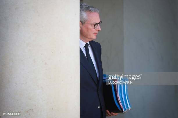 French Economy and Finance Minister Bruno Le Maire leaves the Elysee Presidential Palace after a weekly cabinet meeting on May 27, 2020 in Paris, as...