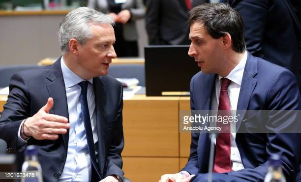 French Economy and Finance Minister Bruno Le Maire talks with Dutch Finance Minister Wopke Hoekstra during an Economic and Financial Affairs Council...