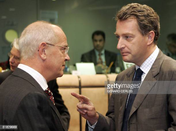 French Economy and Finance Minister Herve Gaymard chats with German counterpart Hans Eichel prior the Eurogroup council at the EU headquarters in...