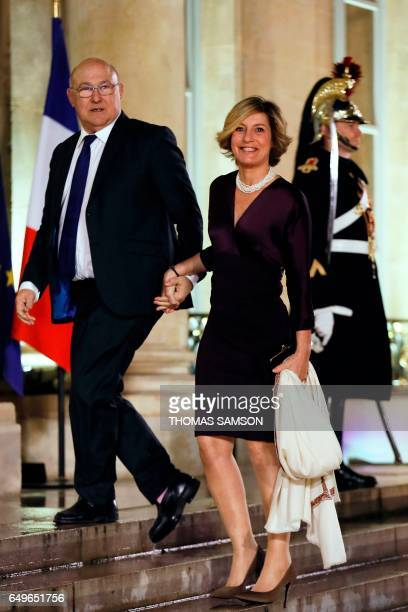 French Economy and Finance Minister Michel Sapin arrives with his wife Valerie de Senneville at the Elysee Palace in Paris to attend an official...