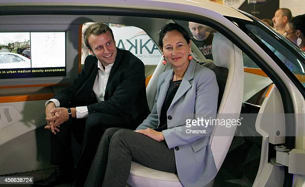 French Economy and Industry minister Emmanuel Macron and minister for Ecology Sustainable Development and Energy Segolene Royal sit in an AKKA...