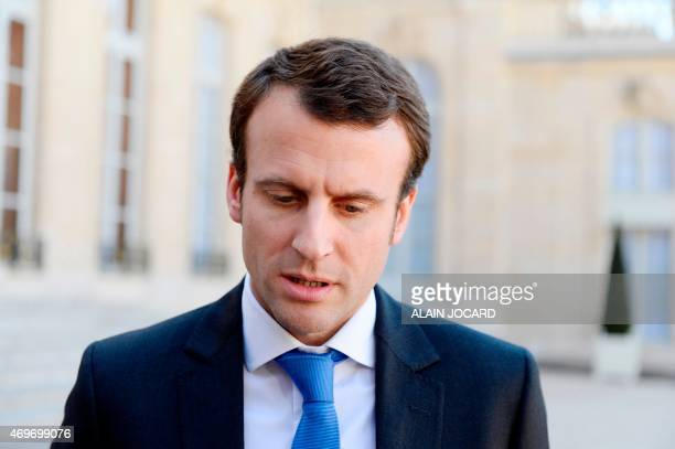 French Economy and Industry minister Emmanuel Macron talks to the press after a meeting with Telecom equipment maker AlcatelLucent's Chief Executive...