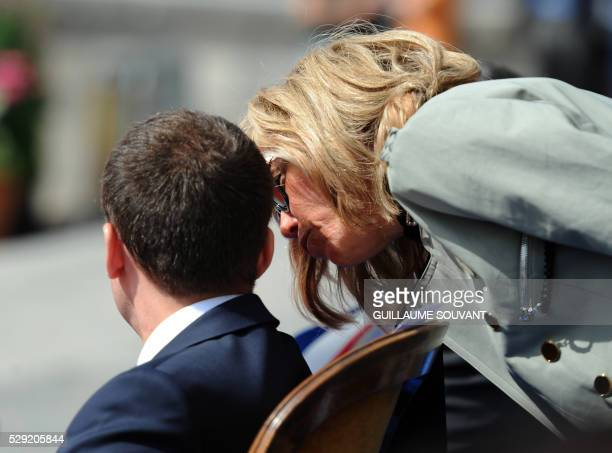 French Economy and Industry Minister Emmanuel Macron talks with his wife Brigitte Trogneux during the official tribute to Jeanne D'Arc at the...
