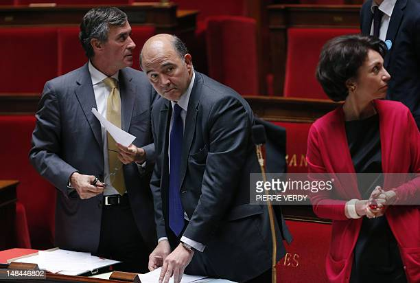 French Economy Finance and Foreign Trade Minister Pierre Moscovici stands near Junior Minister for Budget Jerome Cahuzac and Social Affairs and...