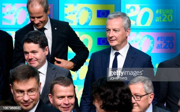 French Economy Finance Trade Minister Bruno Le Maire joins other ministers for a family photo marking the twentieth anniversary of the Euro during an...