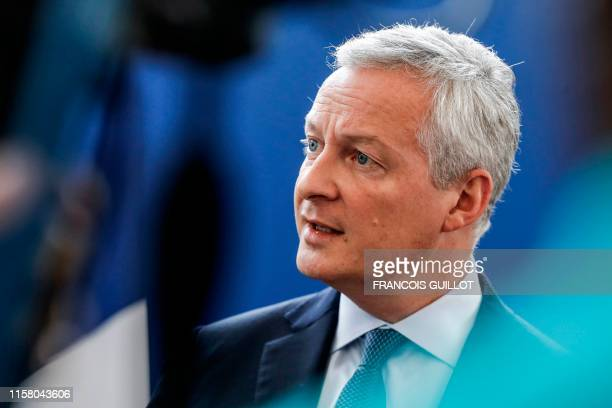 French Economy Minister Bruno Le Maire addresses journalists at his ministry in Paris on July 27 2019 a day after US President vowed substantial...