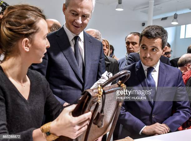 French Economy Minister Bruno Le Maire and French Minister of Public Action and Accounts Gerald Darmanin speak with an employee as they are shown a...