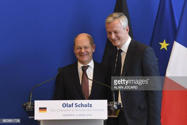 French Economy Minister Bruno Le Maire and German Economy and Finance Minister and ViceChancellor Olaf Scholz leave after a joint press conference...