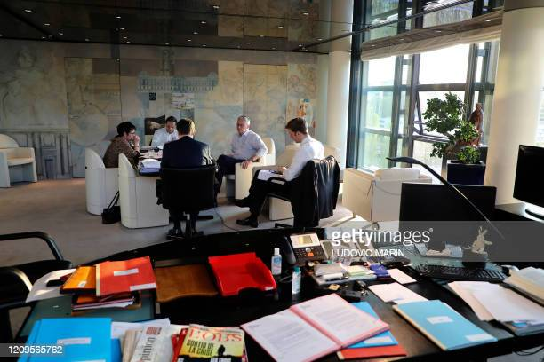 French Economy Minister Bruno Le Maire and his advisors cabinet director Emmanuel Moulin deputy cabinet director Thomas Revial and Treasury managing...