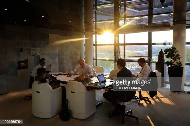 French Economy Minister Bruno Le Maire and his advisors negociate with European partners on the phone before the Eurogroup meeting at the minister's...