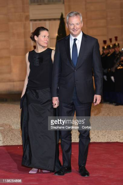 French Economy minister Bruno Le Maire and his wife arrives at a state dinner with French President Emmanuel Macron and Chinese President Xi Jinping...