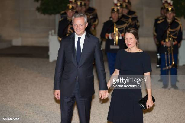 French Economy Minister Bruno Le Maire and his wife Pauline Doussau de Bazignan attend a State dinner offered by French President Emmanuel Macron in...
