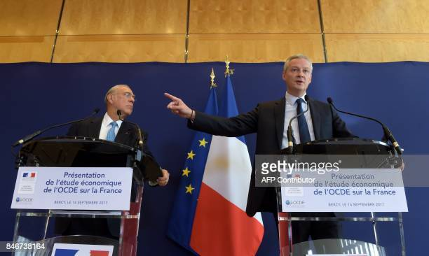 French Economy Minister Bruno Le Maire and OECD Secretary General Angel Gurria give a press conference at the French Economy ministry to present the...