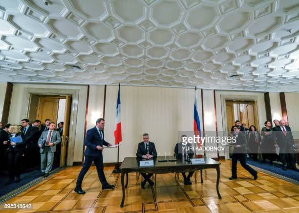 French Economy Minister Bruno Le Maire and Russian Economy Minister Maxim Oreshkin attend a signing ceremony following their meeting in Moscow on...