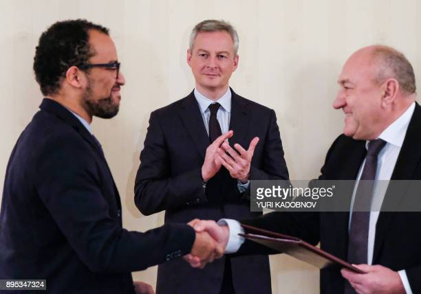 French Economy Minister Bruno Le Maire applauds during a signing ceremony following a meeting with Russian Economy Minister in Moscow on December 19...