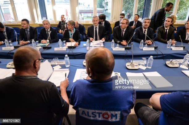 French Economy Minister Bruno Le Maire French Transports Minister Elisabeth Borne and Alstom CIO Henri PoupartLafarge take part to the Alstom...
