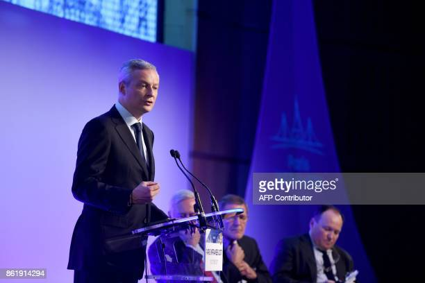 French Economy Minister Bruno Le Maire gestures as he delivers a speech during a conference on the Paris Europlace International Infrastructure Forum...