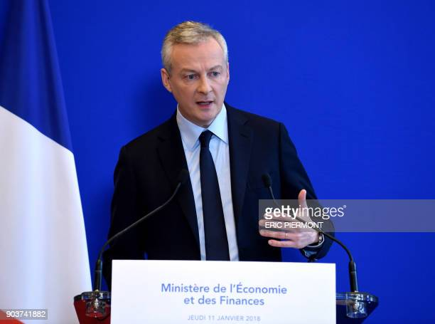 French Economy Minister Bruno Le Maire gives a press conference at the economy ministry on January 11 2018 in Paris regarding the milk contamination...