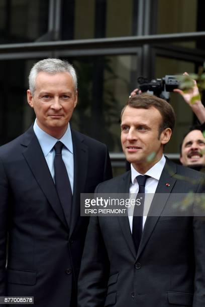 French Economy Minister Bruno Le Maire greets French President Emmanuel Macron upon his arrival for a meeting on 'Technology breaks and Inequalities'...
