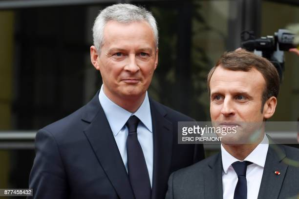 French Economy Minister Bruno Le Maire greets French President Emmanuel Macron upon his arrival for a meeting on Technology breaks and Inequalities...