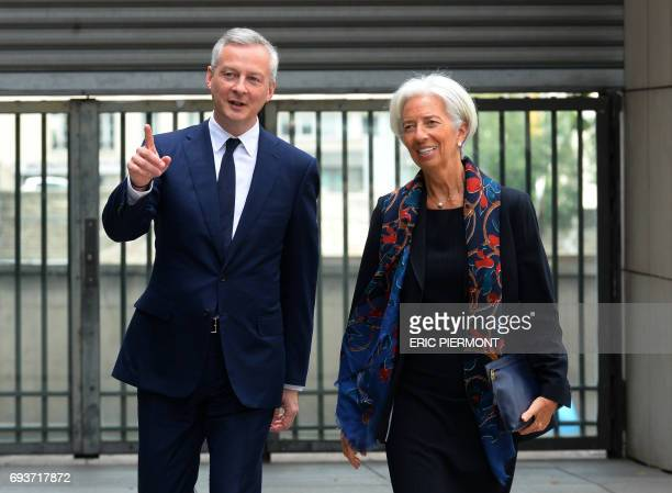 French Economy Minister Bruno Le Maire greets International Monetary Fund Managing Director Christine Lagarde at the Economy Ministry in Paris on...