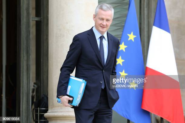 French Economy Minister Bruno Le Maire leaves the Elysee presidential palace after a weekly cabinet meeting on January 24 2018 in Paris