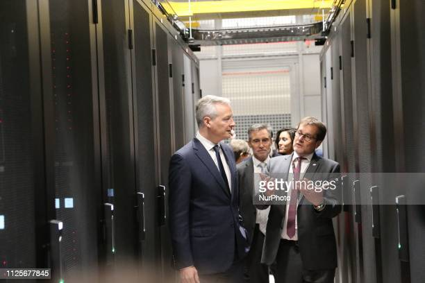 French Economy Minister Bruno Le Maire listens on as he attends the inauguration of the Equinix Paris data centre called PA8 the company's first...
