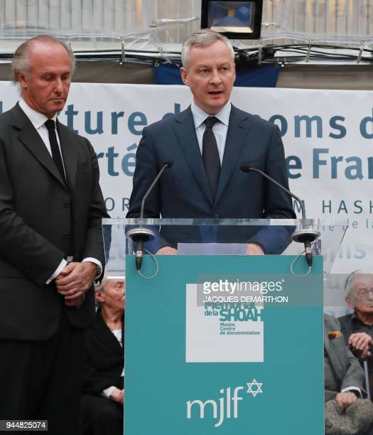 French Economy Minister Bruno Le Maire reads out names of World War II deported jews flanked by Shoah Memorial vicepresident Francois Heilbronn...